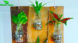 indoor wall hanging water garden wall mounted water garden using glass bottles green plants