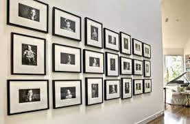 If you're looking for a unique way to display your family photos, try  creating a gallery wall using dramatic black and white photos.