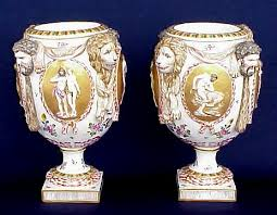 19th c italian porcelain urns on pedestals with alternating panels depicting man s superiority over humans and beasts crown with n underglaze markings