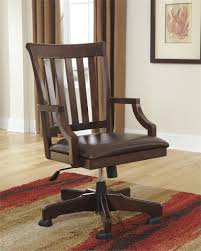 Varnished Sclupture Wood Desk Combined With Rustic Brown Wooden Swivel Chair  In Exposed93