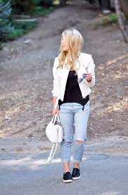 light wash ripped jeans white leather jacket