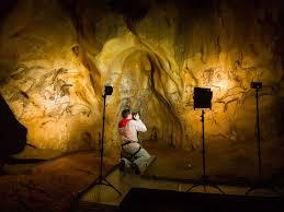 stephen alvarez photographs ancient art in chauvet cave by kneeling on a narrow metal walkway image credits stephen alvarez national geographic