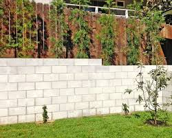 cinder block and wood fence