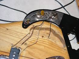 wiring on a fender precision com any pics or diagrams of the correct wiring would be greatly appreciated if you need more photos please ask