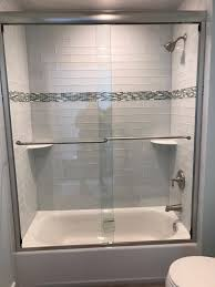 bathroom with glass bathtub doors marlboro nj