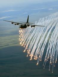 ac 130 flares. a c-130 hercules releases flares during exercise red flag in alaska. are ac 130