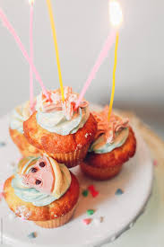 Birthday Cupcakes On A Platter With Candles Stocksy United