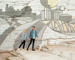 <b>Couple</b> walking dog at wall with <b>graffiti</b> by Duet Postscriptum ...