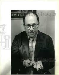 1989 Press Photo Dentist Dr. Charles Tager displaying a dental ...