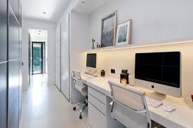 home office white. Desk Sits Below A Small Floating Shelf With Hidden Lighting, While The Long White Hallway Provides Perfect Space For Tucked-away Home Office. Office