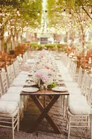 outdoor wedding lights. beautiful outdoor wedding lighting with large bulbed string lights strung across the table.
