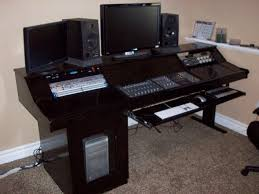 elegant black wood studio desk designs with useful space to save the electronic tools for interior