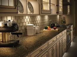 kitchen lighting trend. kitchen inspiring modern interior design alongside beige backsplash trend tile touched with hiden lighting and cabinet set