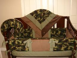 camo baby bedding sets together with brown wooden bed frame varnished with brown colours as well as cream baby room wall decorations