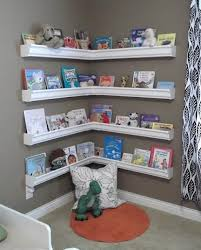 diy rain gutter kid s bookshelves this could be the best re purposing project i have seen so far what a great idea and the books or wver