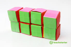 step 11 fold the two ends back to the same colour and pick up all 8 blocks and place them on the side like the image below