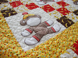 Virtual show and tell: Sock Monkey baby quilt | Quilt Addicts ... & So I combined them, alternating appliqued sock monkeys with nine patch  blocks, all framed in a yellow border and more simple patchwork squares for  a second ... Adamdwight.com
