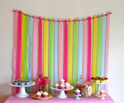 to keep the crepe paper from moving too much i also taped the end of each strip of crepe paper to the wall just below the table height