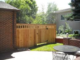 Exterior:Calm Wooden Fence Design For Your Backyard Combine With Exposed  Brick Wall Cool Fence