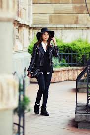 virgit canaz is wearing a hat from h m jumper and leather jacket from mango