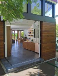 contemporary kitchen floor tile designs. smart gray slate works perfectly with warm brown wood and sleek contemporary fittings. kitchen floor tile designs