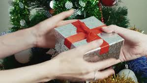 Hugging On Christmas Stock Photo  Getty ImagesGiving Gifts On Christmas