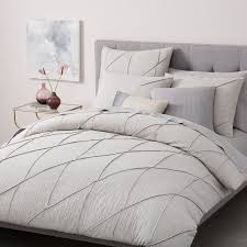 grey and white patterned sheets