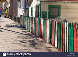 Painted Fences houses with wooden fences painted in the colors of the italian 3575 by xevi.us