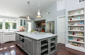 gray kitchen island with and white cabinets marble counters grey
