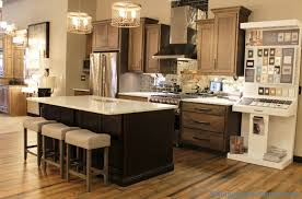 koch cabinetry hickory stone finish kitchen display with antiqued mirror backsplash tile villagehomes