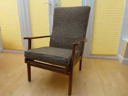high back wooden frame armchair brown fabric seat cushion and back rest