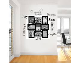 decoration family photo wall art design with es and black wooden frame on the white