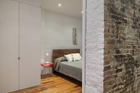 view in gallery painted brick in a new york bedroom