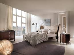contemporary master bedroom design with cool chrome polished arch lamp and black lacquered oak wood bed bedroom light fixtures