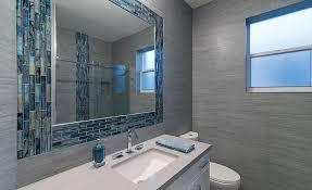 for a residential remodel neutral palette of porcelain tile glass