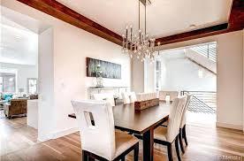 jonathan adler meurice dining room with hardwood floors light rectangular chandelier