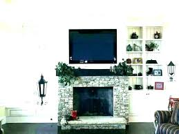 mounting tv over fireplace above fireplace wires above gas