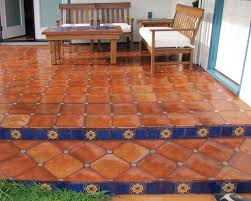 mexican floor tile combined with talavera tile inserts