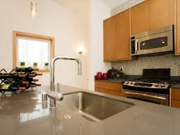 kitchen countertop options sleek kitchen modern brown kitchen mahogany wood kitchen island quartz island countertop white exposed brick tile wall
