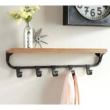 pottery barn wall shelves pottery barn wall shelf with flat iron hooks a liked on featuring pottery barn wall shelves