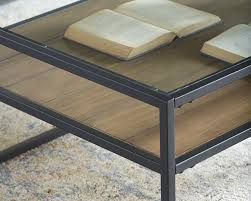 spectacular and sensible the showcase coffee table is tastefully designed the flawless blending of the glass top with a metal frame and ranch finished