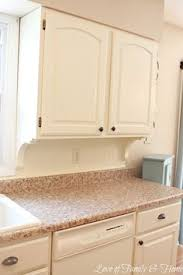 white kitchen adding beadboard corbels underneath the kitchen cabinets for a built in custom look