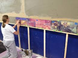 exterior tile wall installation. the best tile mortars for exterior installations like this mural combine bond strength with fl exibility wall installation m
