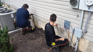 hdtv magazine hdtv expert xfinity ldquo the future of awesome rdquo is the tech fastens the house cable while a supervisor installs a termination box and ground wire