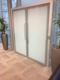 this picture shows a pair of toughened glass doors that were silk screen to produce an obscured milky white central section with a solid grey border