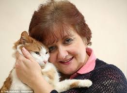 Lesley Corbett of Stoke-on-Trent with cat Jessie who went missing for eight years before returning - article-2577986-1C2A04CD00000578-309_634x465