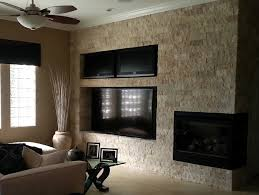 tiletuesday highlights an installation of our limestone chiseled as the accent wall and fireplace décor