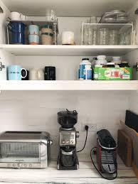 shelf with mugs jars and shelf organizers