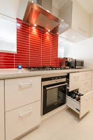 over stove lighting. Kitchen Storage Ideas With Built In Microwave And Under Counter Lighting Also Stove Plus Red Tile Colors For Wall Range Hood Over The