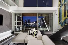 Living room and balcony in small apartment by SAOTA, De Waterkant, Cape  Town. Interior design ...
